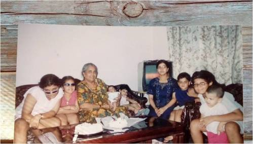 Virat's grandmother with kids (2004)...celebrating his 1st month's birthday